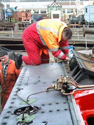 Colin Springthorpe paints a piece of smokebox saddle cladding. February 07 2004