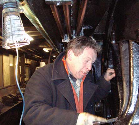 John Salter cleans the centre driving wheels so they are ready for a coat of gloss black paint. February 28 2004