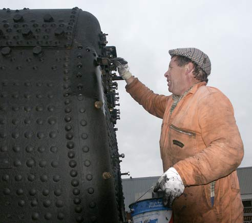 John Salter looks in pain as he give the firebox a second coat of paint. May 17 2003 © Martyn Bane
