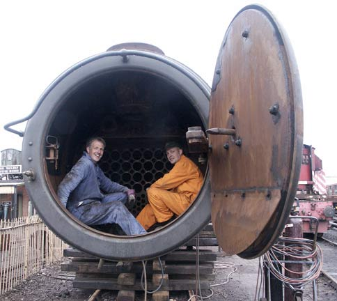 A right pair of posers in the smokebox. Richard Jones (left) and Colin Jeffery take a break from removing superheater element studs. May 17 2003 © Martyn Bane