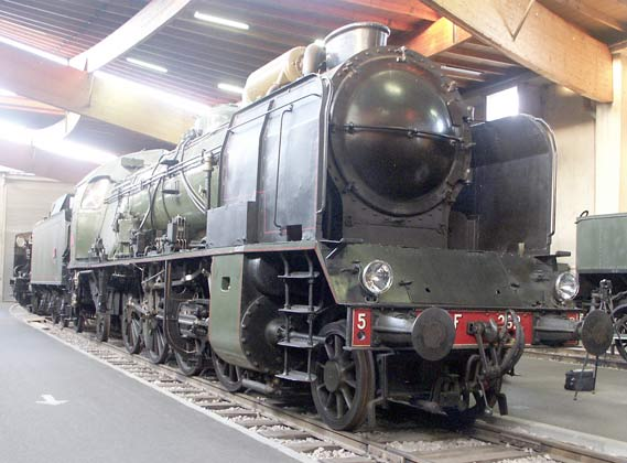 A former PLM type locomotive in SNCF guise, this is 2-8-2 141F282. It is a 4 cylinder compound on the PLM system. The inside cylinders are the high pressure ones and the outside are the low pressure. May 30 2003