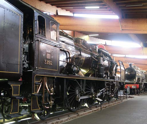 3.1192 is kept in excellent condition by the museum staff, as befits such an important locomotive. On this side of the locomotive the turbo generator, cross compound air brake pump and one of the ACFI feedwater barrels are visible. Also to the right of the cab steps is the live steam injector used when the locomotive was not under steam. If the ACFI system had been used when there was no exhaust steam to heat the feedwater cold water would have entered the boiler. May 31 2003