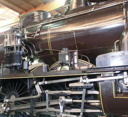 A closer view of the valve gear, air pump and also the mechanical lubricator on 3.1192. Note the beautifully laid out copper lubrication pipework to the right of the lubricator. May 31 2003