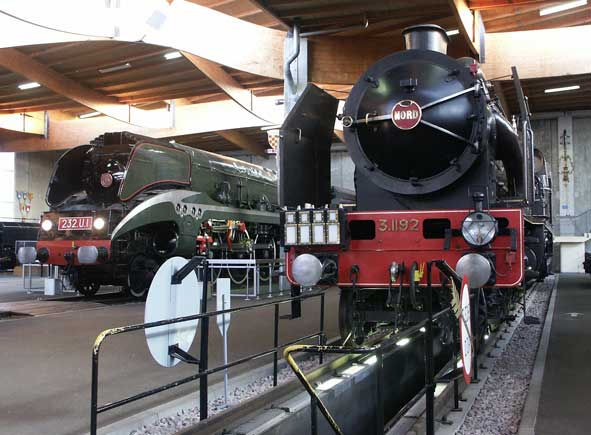 The two stars of the Mulhouse museum are De Caso designed SNCF 4-6-4 compound 232U1 (left) and the Chapelon designed Nord compound 4-6-2 3.1192 (SNCF 231E22.) May 31 2003