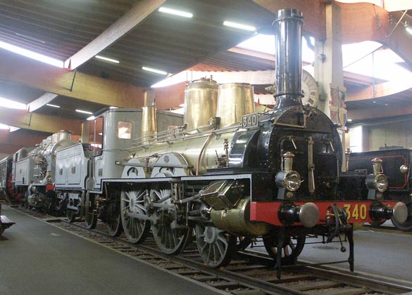 This rather old Pairs Orleans Railway 2-4-2 340, a product from the 1880s, is notable for the amount of brasswork. Keeping the boiler clean must have been a full time job ! May 31 2003