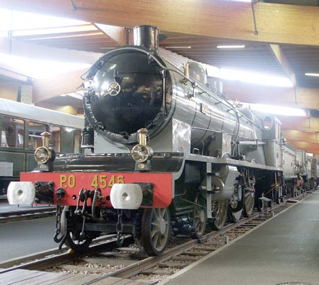 From this type to the type below with a little bit of help from Monsieur Chapelon.... Some of the Paris Orleans 4500 class Pacifics, which themselves were good locomotives for their day, were rebuilt to become the very successful 4700 class 4-8-0, later 240.700 and 240A700 type, for the PO and later a further 25 were rebuilt, to an even better design, as 240Ps to operate in former PLM territory. May 31 2003