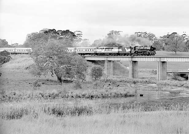 R711 & S302 cross Mount Emu Creek viaduct on the 08:48 Melbourne Spencer Street to Warrnambool service. September 2001.