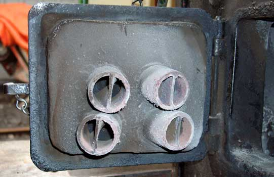 With the exception of Hawk all the locos have a similar cast and fabricated section on the fire side of the firehole door. This is used to direct the secondary air evenly over the fire and impart extra turbulence with the swirl shaped plates in the ducts (these being the fabricated sections.) The secondary air ducts have an area of approximately 2% of the grate area. Again this is on Badger. April 12 2004