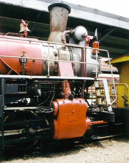 To clear the enlarged superheater header the exhaust arrangement is at an angle. Also note the closed type feedwater heater mounted on the front of the enlarged smokebox. 1999. © Shaun McMahon
