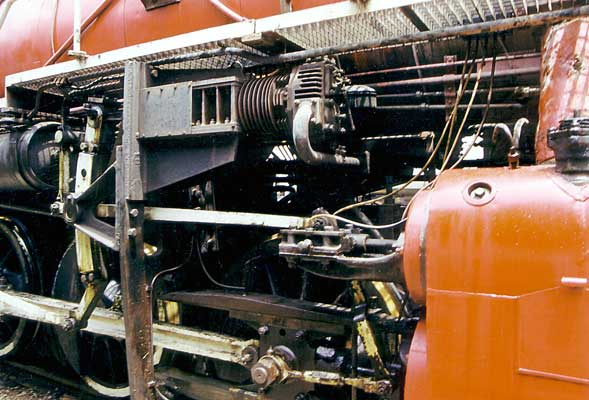 On each side of the loco converted Chinese built truck engines are set up as mechanical air brake pressure maintainers. Each is driven from an extension to the expansion link. 1999. © Shaun McMahon
