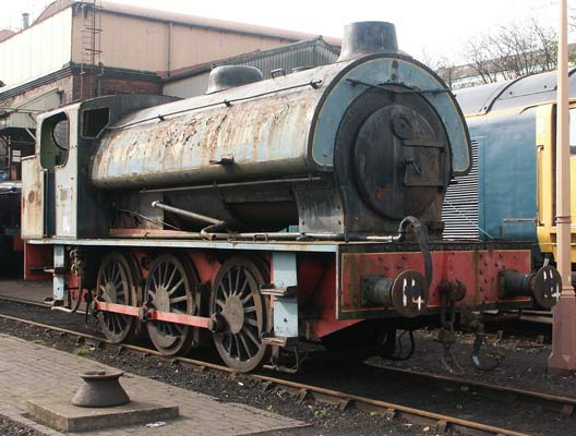 'Austerity'        0-6-0st type RSH No. 7289 'Fred' sits at Tyseley Locomotive Works. A give away to the presence of modification is the vacuum/smoke regulator on the upper part of the smokebox door and the distinctive chimney shape. April 13 2003.