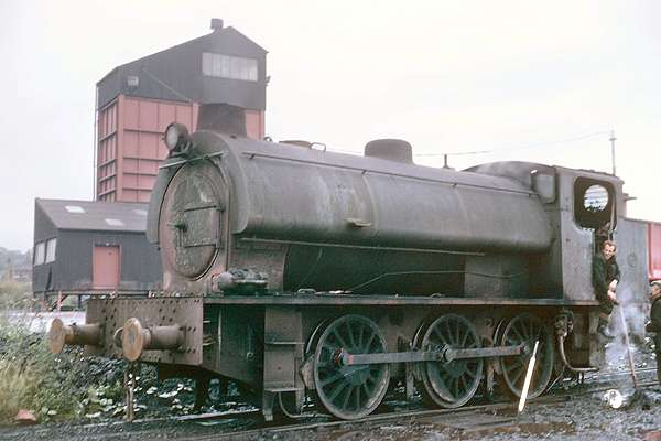 Hunslet No.3212 of 1945. Fitted with a turbo-generator and headlamp the loco is seen, in desperate need of a clean, at North Gawber colliery. July 1969 © G.A.Cryer