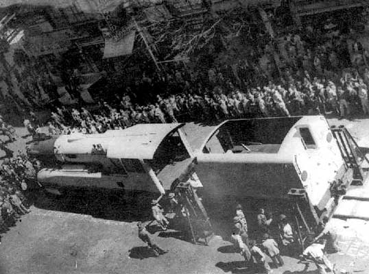 Large crowds witness the preparation for display of 'Argentina'. Note the jacks used for unloading and the roomy cab. 1949