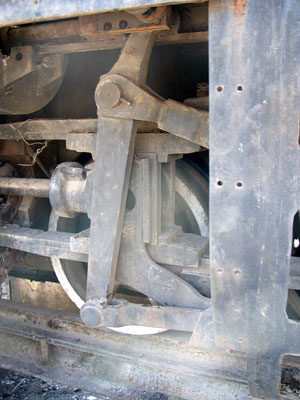On the lefthand side a little of the motion remains. This shows the combination (lap and lead) lever, the interestingly arranged drive from the crosshead and the connection with the radius rod and valve stem crosshead. October 14 2004