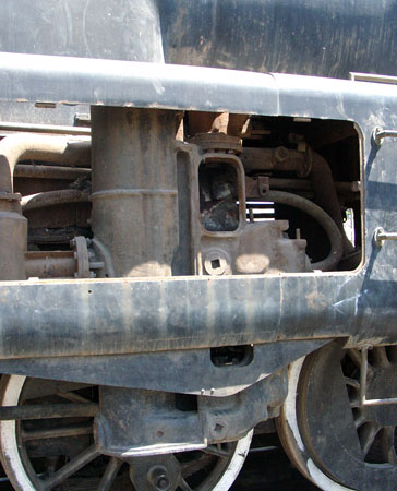 The air pump is situated above the rear driven axle on the fireman's side of the loco. As can be seen the pump is of substantial construction. October 14 2004