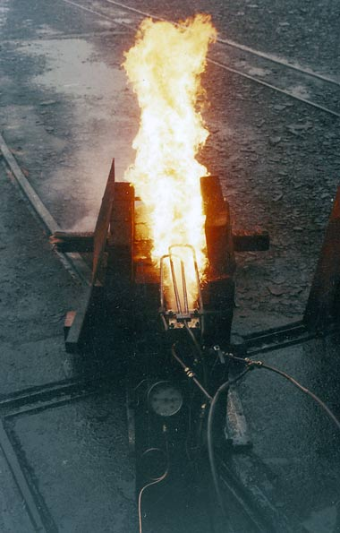 One of the burner experiments. Note the loops of pipework towards the rear of the flames. These superheat the atomising steam. Superheat is an important improvement for all oil firing systems. © Nigel A. H. Day