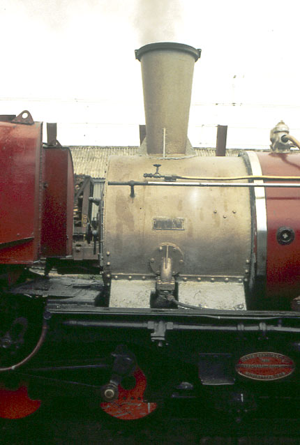 A wider shot than above giving a better idea of the scale of the chimney relative to the rest of the locomotive. The smokebox is painted with a heat resistant paint. Note the builders plate on the boiler craddle bottom right. 1998 © Nigel A.H. Day