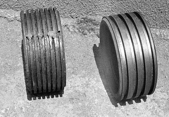On the right as the original NGG16 type ring retainer equipped with 4 wide rings (not fitted) whilst on the left is an experimental 8 iron ring version trailed on 155. 141 was fitted with a 7 bronze ring version and retained them whilst in service. The use of extra rings provides greater steam tightness and a lower specific bearing pressure. November 1993. © Shaun McMahon
