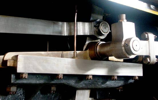 To allow the Walschaerts valves gear to drive the oscillating cam an extension protrudes at 90° to what would be the valve steam crosshead on a piston valve engine. This extension allows the rod driving the cam to clear the outside face of the cylinder. October 9 2003