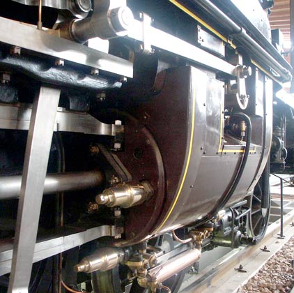 This view shows not only the detail of the final drive to the camshaft but also the pressure relief valves and the copper cover over the drain cock pipes. October 9 2003