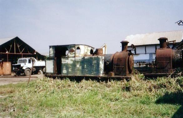 "No.2165 of 1958. This is the very last steam loco to be produced by Pecketts. It is seen at Marromeu prior to transportation to Sandstone Heritage Trust works in South Africa. Built for the 3' gauge this 0-6-0t has now been converted to 3'6"" gauge. © Geoff Pethick"