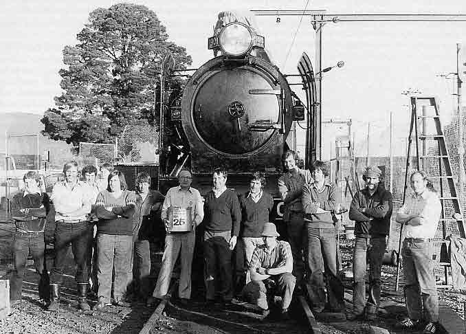 Towards the completion of K 190's restoration at Bayswater a group shot was taken of many Steamrail volunteers who worked on the project. They are (l to r) Adrian Kiely, Tony Marsden, (man with child unknown), Peter Keen, Ron Williams, Don Potts, Kevin and Tom Clark, Neil (surname unknown), Murray McEwan, Warren Banfield, Steve Bucton, Ian Morrison. October 1979. LATE GRANT GEDDES COLLECTION; COURTESY K. AND T. CLARK