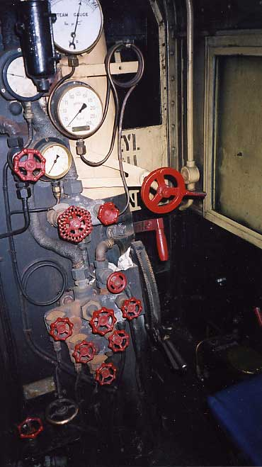 The fireman's side of the cab showing the revised water gauge arrangement. Certain stoker controls have been arranged for the oil firing whilst the oil feed valve control is to the right of what were stoker jet controls. September 2001.