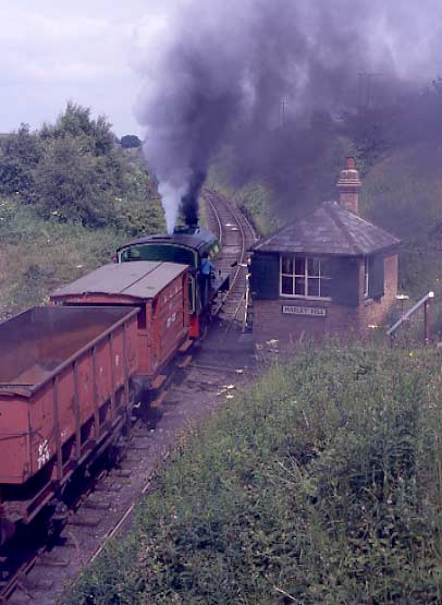 No.49 hauls a coal train past Marley Hill signalbox. July 2 1995