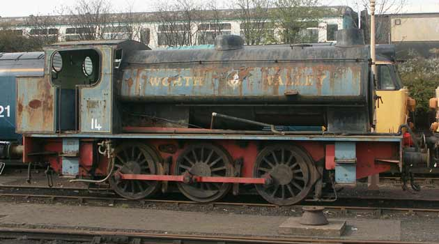 'Austerity' 0-6-0st type RSH No. 7289 'Fred' sits at Tyseley Locomotive Works. Note the vacuum brake pipework on the running plate - a preservation days addition. I assume it was not always in the current position ! April 13 2003.