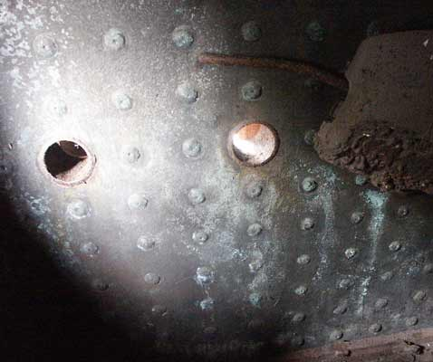 Two of the three overfire air holes for the GPCS in the left handside of the firebox on RSH No. 7289. April 13 2003
