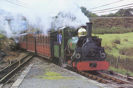 Shortly after conversion in 1985 Linda displays perfect combustion as she hauls an up train into Ddaullt. The Fireman is the FR's then Operating Manager Terry Turner. He is now General Manager on the Welshpool and Llanfair Light Railway. Behind him, just visible, is Phil Girdlestone monitoring performance. © G. Rushton